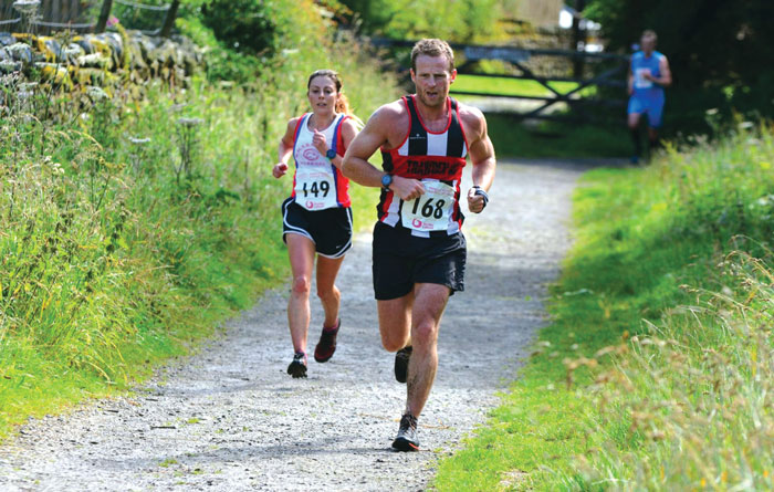 Neil Smith running in the colours of Trawden Athletic