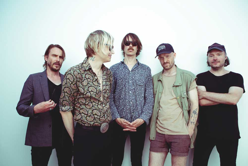Dennis Lyxzén second from left with band Refused